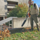 Kyle Riggs uses a battery-powered leaf blower on the SOU campus